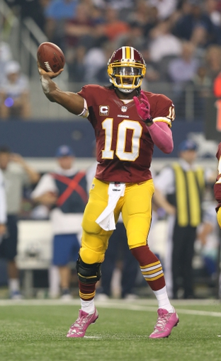 Oct 13, 2013; Arlington, TX, USA; Washington Redskins quarterback Robert Griffin III (10) throws in the pocket in the second quarter against the Dallas Cowboys at AT&T Stadium. Mandatory Credit: Matthew Emmons-USA TODAY Sports