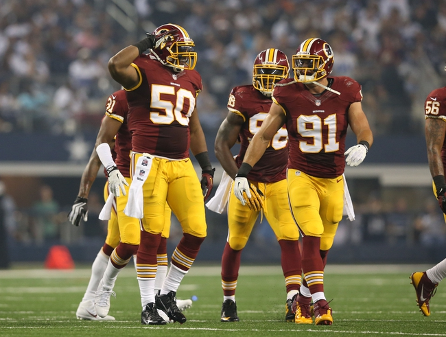 Oct 13, 2013; Arlington, TX, USA; Washington Redskins linebacker Rob Jackson (50) celebrates after an interception in the second quarter against the Dallas Cowboys at AT&T Stadium. Mandatory Credit: Matthew Emmons-USA TODAY Sports