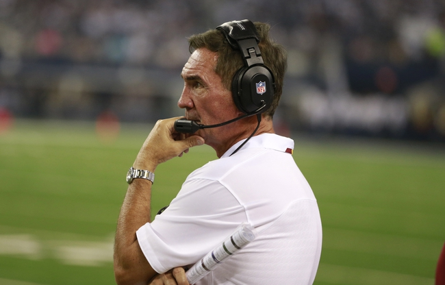 Oct 13, 2013; Arlington, TX, USA; Washington Redskins head coach Mike Shanahan watches a play during the game against the Dallas Cowboys at AT&T Stadium. The Dallas Cowboys beat the Washington Redskins 31-16. Mandatory Credit: Tim Heitman-USA TODAY Sports