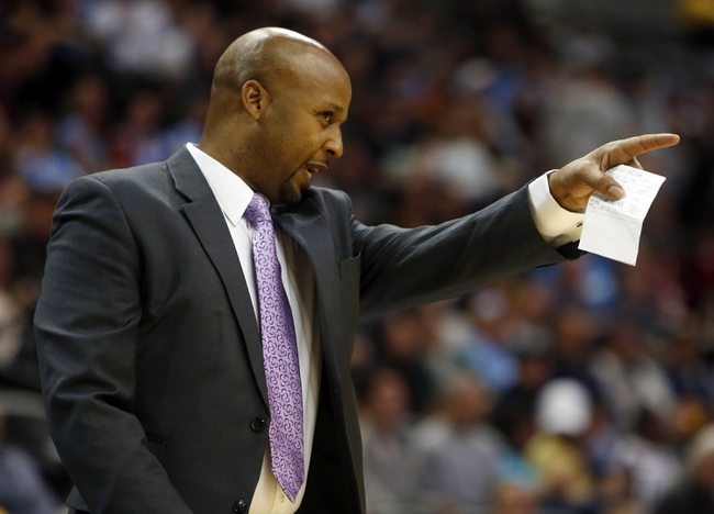 Oct 14, 2013; Denver, CO, USA;  Denver Nuggets head coach Brian Shaw signals from the bench during the first half against the San Antonio Spurs at Pepsi Center. Mandatory Credit: Chris Humphreys-USA TODAY Sports