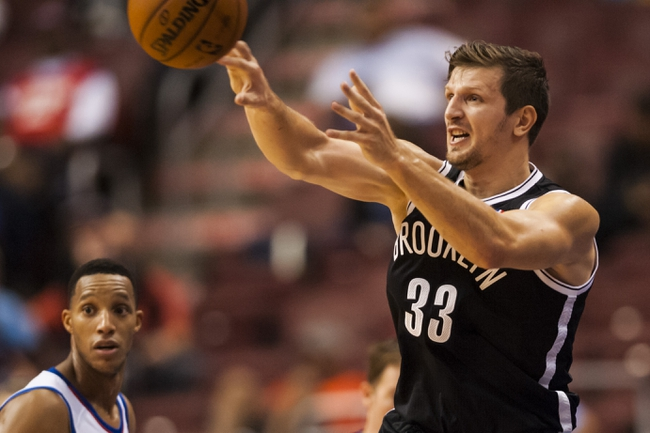 Oct 14, 2013; Philadelphia, PA, USA; Brooklyn Nets forward Mirza Teletovic (33) passes the ball during the fourth quarter against the Philadelphia 76ers at Wells Fargo Center. The Nets defeated the Sixers 127-97. Mandatory Credit: Howard Smith-USA TODAY Sports