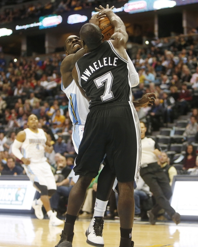 Oct 14, 2013; Denver, CO, USA;  Denver Nuggets forward J.J. Hickson (7) drives to the basket against San Antonio Spurs forward Dan Nwaelele (7) during the first half at Pepsi Center. Mandatory Credit: Chris Humphreys-USA TODAY Sports