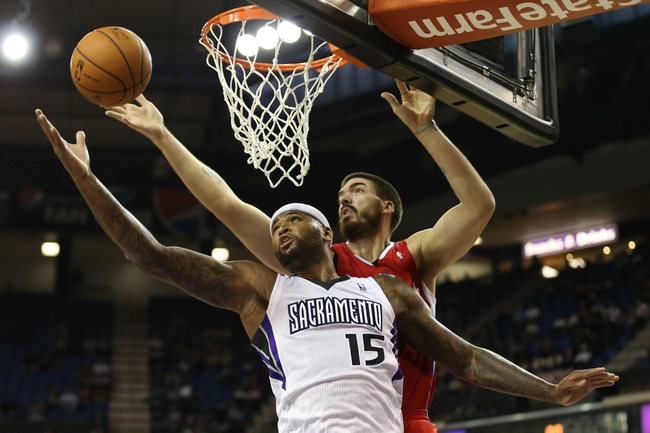 Oct 14, 2013; Sacramento, CA, USA; Sacramento Kings center DeMarcus Cousins (15) battles for the rebound with of Los Angeles Clippers center Byron Mullens (0) during the first quarter at Sleep Train Arena. Mandatory Credit: Kelley L Cox-USA TODAY Sports