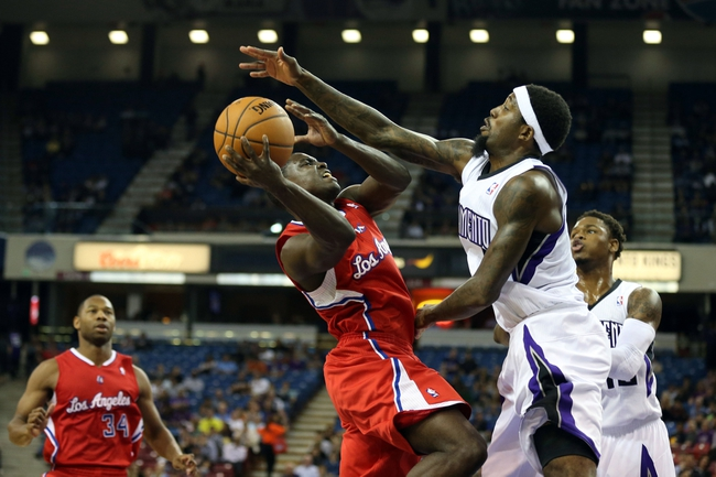 Oct 14, 2013; Sacramento, CA, USA; Sacramento Kings small forward John Salmons (5) fouls Los Angeles Clippers point guard Darren Collison (2) on the shot during the second quarter at Sleep Train Arena. Mandatory Credit: Kelley L Cox-USA TODAY Sports