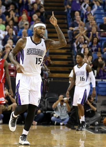 Oct 14, 2013; Sacramento, CA, USA; Sacramento Kings center DeMarcus Cousins (15) points in the air after scoring the last shot of the half against the Los Angeles Clippers during the second quarter at Sleep Train Arena. Mandatory Credit: Kelley L Cox-USA TODAY Sports