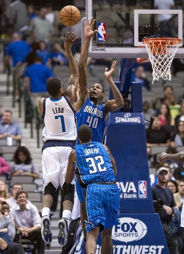 Oct 14, 2013; Dallas, TX, USA; Orlando Magic center Mickell Gladness (40) defends against Dallas Mavericks rookie shooting guard Ricky Ledo (7) during the second half at American Airlines Center. The Magic defeated the Mavericks 102-94. Mandatory Credit: Jerome Miron-USA TODAY Sports