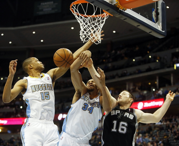 Oct 14, 2013; Denver, CO, USA; San Antonio Spurs forward Aron Baynes (16) battles Denver Nuggets center JaVale McGee (34) and forward Anthony Randolph (15) for a rebound during the second half at Pepsi Center. The Nuggets won 98-94. Mandatory Credit: Chris Humphreys-USA TODAY Sports