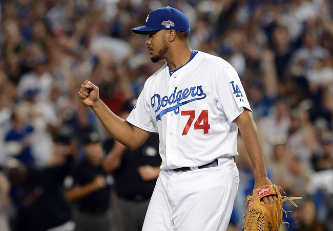 October 14, 2013; Los Angeles, CA, USA; Los Angeles Dodgers relief pitcher Kenley Jansen (74) celebrates the 3-0 victory against the St. Louis Cardinals in game three of the National League Championship Series baseball game at Dodger Stadium. Mandatory Credit: Jayne Kamin-Oncea-USA TODAY Sports