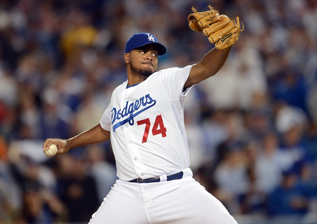 October 14, 2013; Los Angeles, CA, USA; Los Angeles Dodgers relief pitcher Kenley Jansen (74) pitches the ninth inning against the St. Louis Cardinals in game three of the National League Championship Series baseball game at Dodger Stadium. Mandatory Credit: Jayne Kamin-Oncea-USA TODAY Sports