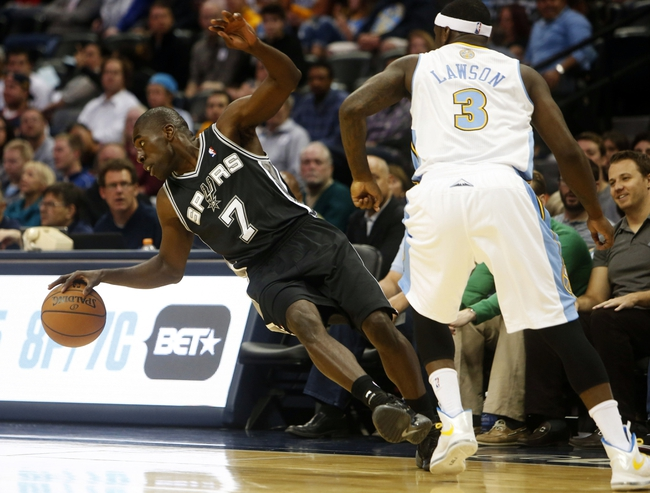 Oct 14, 2013; Denver, CO, USA; San Antonio Spurs guard Dan Nwaelele (7) tries to regain control of the ball in front of Denver Nuggets guard Ty Lawson during the second half at Pepsi Center. The Nuggets won 98-94. Mandatory Credit: Chris Humphreys-USA TODAY Sports