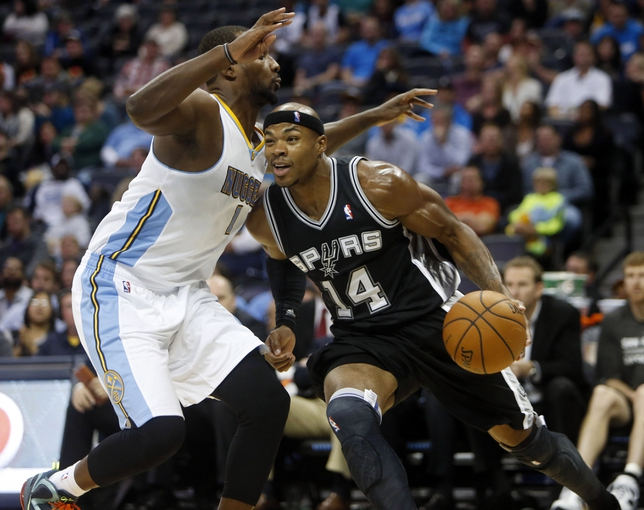 Oct 14, 2013; Denver, CO, USA; San Antonio Spurs forward Corey Maggette (14) with the ball during the second half against the Denver Nuggets at Pepsi Center. The Nuggets won 98-94. Mandatory Credit: Chris Humphreys-USA TODAY Sports