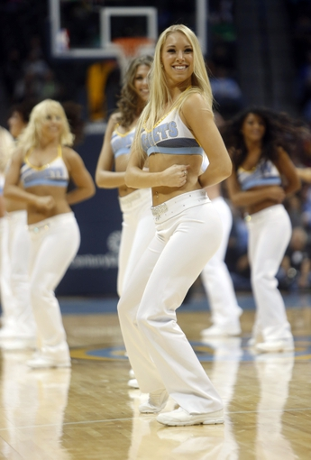 Oct 14, 2013; Denver, CO, USA; Denver Nuggets cheerleaders perform during the second half against the San Antonio Spurs at Pepsi Center. The Nuggets won 98-94. Mandatory Credit: Chris Humphreys-USA TODAY Sports