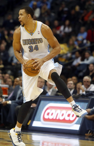 Oct 14, 2013; Denver, CO, USA; Denver Nuggets center JaVale McGee (34) gains control of the ball during the second half against the San Antonio Spurs at Pepsi Center. The Nuggets won 98-94. Mandatory Credit: Chris Humphreys-USA TODAY Sports