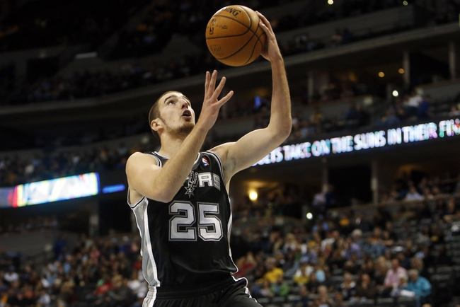 Oct 14, 2013; Denver, CO, USA; San Antonio Spurs guard Nando De Colo (25) drives to the basket during the second half against the Denver Nuggets at Pepsi Center. The Nuggets won 98-94. Mandatory Credit: Chris Humphreys-USA TODAY Sports