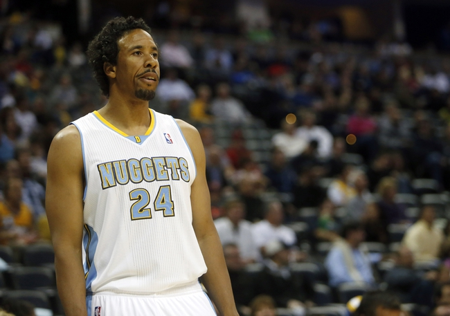 Oct 14, 2013; Denver, CO, USA;  Denver Nuggets guard Andre Miller (24) reacts during the first half against the San Antonio Spurs at Pepsi Center. Mandatory Credit: Chris Humphreys-USA TODAY Sports