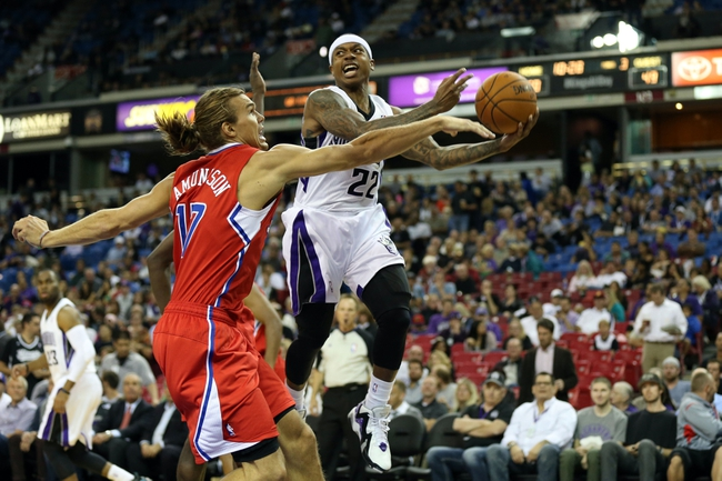 Oct 14, 2013; Sacramento, CA, USA; Sacramento Kings point guard Isaiah Thomas (22) controls the ball mid-air against Los Angeles Clippers power forward Lou Amundson (17) during the third quarter at Sleep Train Arena. The Sacramento Kings defeated the Los Angeles Clippers 99-88. Mandatory Credit: Kelley L Cox-USA TODAY Sports