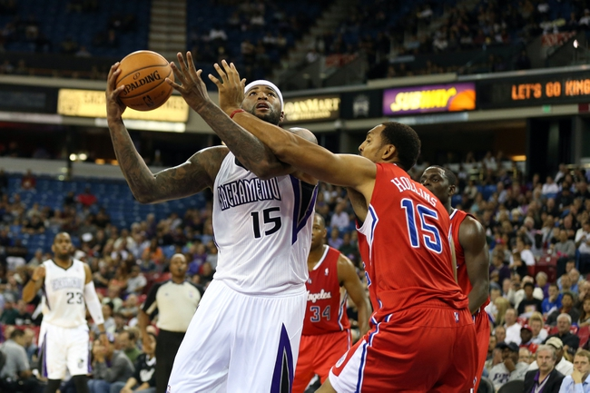 Oct 14, 2013; Sacramento, CA, USA; Sacramento Kings center DeMarcus Cousins (15) looks to shoot the ball against Los Angeles Clippers center Ryan Hollins (15) during the third quarter at Sleep Train Arena. The Sacramento Kings defeated the Los Angeles Clippers 99-88. Mandatory Credit: Kelley L Cox-USA TODAY Sports