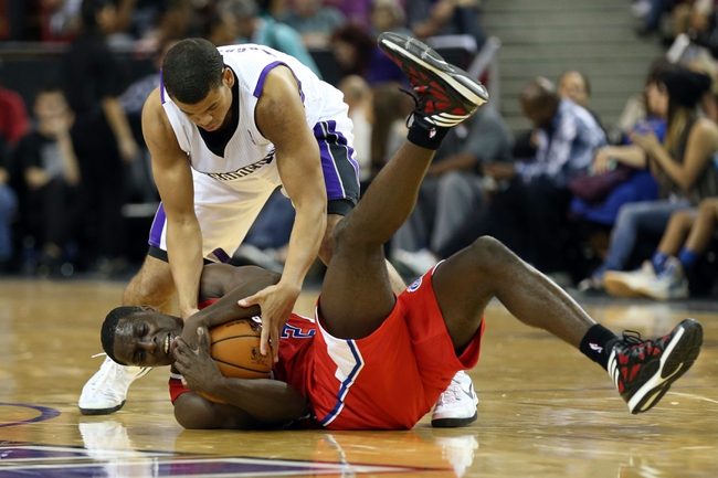 Oct 14, 2013; Sacramento, CA, USA; Sacramento Kings point guard Ray McCallum (3) and Los Angeles Clippers point guard Darren Collison (2) battle for the ball before jump ball is called during the fourth quarter at Sleep Train Arena. The Sacramento Kings defeated the Los Angeles Clippers 99-88. Mandatory Credit: Kelley L Cox-USA TODAY Sports