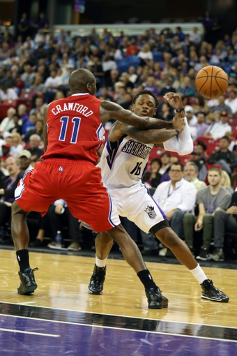 Oct 14, 2013; Sacramento, CA, USA; Los Angeles Clippers shooting guard Jamal Crawford (11) swats away the ball against Sacramento Kings shooting guard Ben McLemore (16) during the fourth quarter at Sleep Train Arena. The Sacramento Kings defeated the Los Angeles Clippers 99-88. Mandatory Credit: Kelley L Cox-USA TODAY Sports