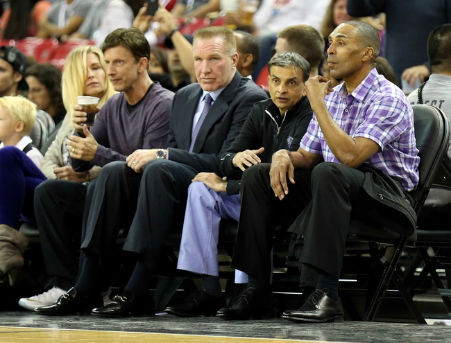 Oct 14, 2013; Sacramento, CA, USA; (L-R) Sacramento Kings owner Mark Mastrov, advisor Chris Mullin, owner Vivek Ranadive, and TIBCO vice president Roger Craig court side before the game against the Los Angeles Clippers at Sleep Train Arena. Mandatory Credit: Kelley L Cox-USA TODAY Sports