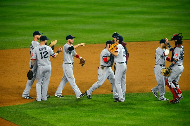 Oct 15, 2013; Detroit, MI, USA;  The Boston Red Sox celebrate after defeating the Detroit Tigers in game three of the American League Championship Series baseball game at Comerica Park. Boston won 1-0. Mandatory Credit: Andrew Weber-USA TODAY Sports