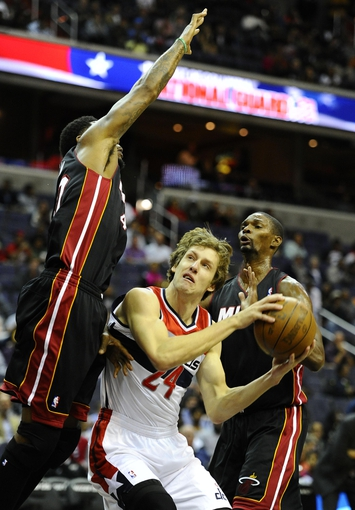 Oct 15, 2013; Washington, DC, USA; Washington Wizards small forward Jan Vesely (24) is defended by Miami Heat power forward Udonis Haslem (40) during the first half at the Verizon Center. Mandatory Credit: Brad Mills-USA TODAY Sports