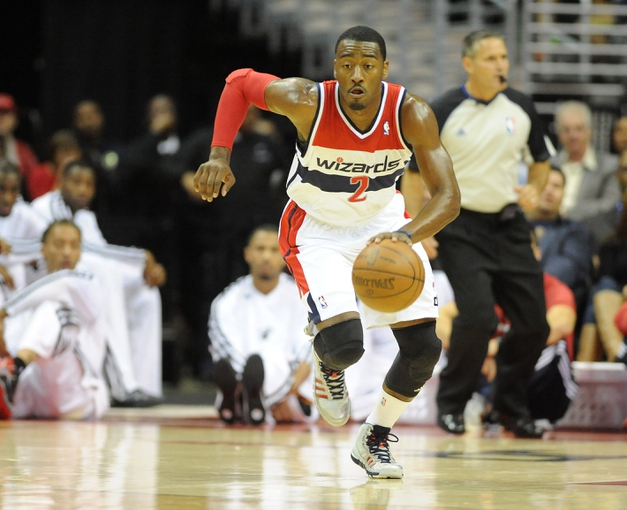 Oct 15, 2013; Washington, DC, USA; Washington Wizards point guard John Wall (2) dribbles the ball against the Miami Heat during the first half at the Verizon Center. Mandatory Credit: Brad Mills-USA TODAY Sports