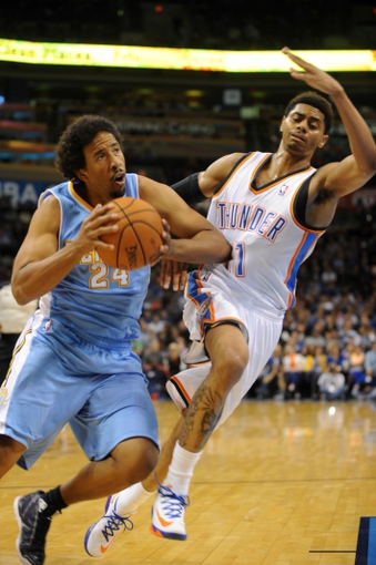 Oct 15, 2013; Oklahoma City, OK, USA; Denver Nuggets point guard Andre Miller (24) handles the ball against Oklahoma City Thunder shooting guard Jeremy Lamb (11) during the second quarter at Chesapeake Energy Arena. Mandatory Credit: Mark D. Smith-USA TODAY Sports