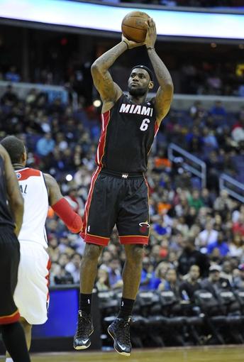Oct 15, 2013; Washington, DC, USA; Miami Heat small forward LeBron James (6) shoots a jump shot against the Washington Wizards during the second half at the Verizon Center. Mandatory Credit: Brad Mills-USA TODAY Sports
