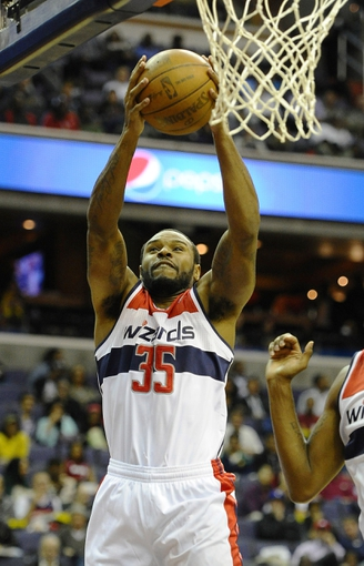 Oct 15, 2013; Washington, DC, USA; Washington Wizards power forward Trevor Booker (35) grabs a rebound against the Miami Heat during the second half at the Verizon Center. Mandatory Credit: Brad Mills-USA TODAY Sports
