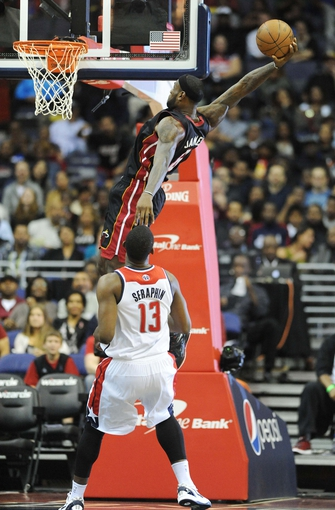 Oct 15, 2013; Washington, DC, USA; Miami Heat small forward LeBron James (6) dunks the ball over Washington Wizards power forward Kevin Seraphin (13) during the first half at the Verizon Center. Mandatory Credit: Brad Mills-USA TODAY Sports