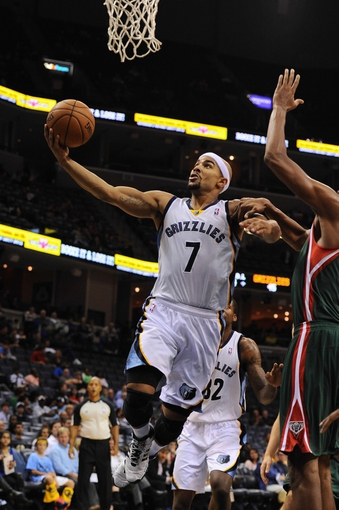 Oct 15, 2013; Memphis, TN, USA; Memphis Grizzlies point guard Jerryd Bayless (7) lays the ball up during the second quarter against the Milwaukee Bucks at FedExForum. Mandatory Credit: Justin Ford-USA TODAY Sports
