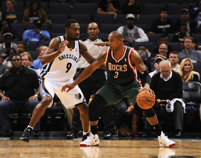Oct 15, 2013; Memphis, TN, USA; Milwaukee Bucks small forward Caron Butler (3) handles the ball against Memphis Grizzlies shooting guard Tony Allen (9) during the second quarter at FedExForum. Mandatory Credit: Justin Ford-USA TODAY Sports