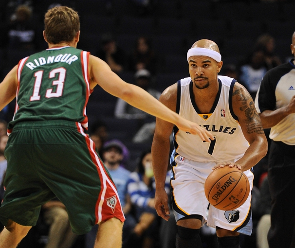 Oct 15, 2013; Memphis, TN, USA; Memphis Grizzlies point guard Jerryd Bayless (7) handles the ball against the Milwaukee Bucks during the second quarter at FedExForum. Mandatory Credit: Justin Ford-USA TODAY Sports