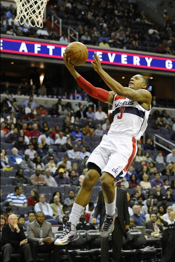 Oct 15, 2013; Washington, DC, USA; Washington Wizards shooting guard Bradley Beal (3) attempts a layup against the Miami Heat during the first half at the Verizon Center. Mandatory Credit: Brad Mills-USA TODAY Sports