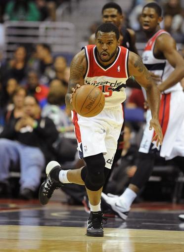 Oct 15, 2013; Washington, DC, USA; Washington Wizards power forward Trevor Booker (35) advances the ball against the Miami Heat during the first half at the Verizon Center. Mandatory Credit: Brad Mills-USA TODAY Sports