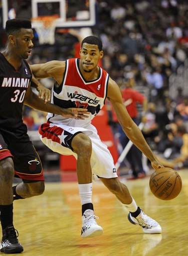 Oct 15, 2013; Washington, DC, USA; Washington Wizards shooting guard Garrett Temple (17) dribbles the ball as Miami Heat point guard Norris Cole (30) defends during the first half at the Verizon Center. Mandatory Credit: Brad Mills-USA TODAY Sports