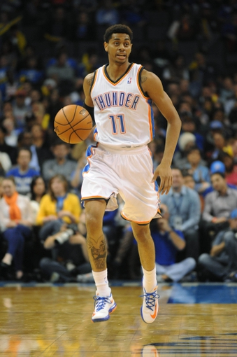 Oct 15, 2013; Oklahoma City, OK, USA; Oklahoma City Thunder shooting guard Jeremy Lamb (11) brings the ball up the court against the Denver Nuggets during the third quarter at Chesapeake Energy Arena. Mandatory Credit: Mark D. Smith-USA TODAY Sports
