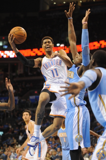 Oct 15, 2013; Oklahoma City, OK, USA; Oklahoma City Thunder shooting guard Jeremy Lamb (11) attempts a shot against Denver Nuggets small forward Quincy Miller (30) during the third quarter at Chesapeake Energy Arena. Mandatory Credit: Mark D. Smith-USA TODAY Sports