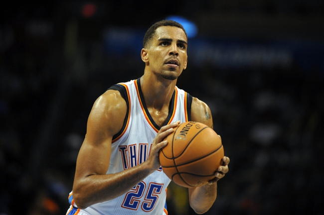 Oct 15, 2013; Oklahoma City, OK, USA; Oklahoma City Thunder shooting guard Thabo Sefolosha (25) attempts a shot against the Denver Nuggets during the fourth quarter at Chesapeake Energy Arena. Mandatory Credit: Mark D. Smith-USA TODAY Sports