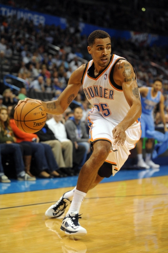 Oct 15, 2013; Oklahoma City, OK, USA; Oklahoma City Thunder shooting guard Thabo Sefolosha (25) handles the ball against the Denver Nuggets during the third quarter at Chesapeake Energy Arena. Mandatory Credit: Mark D. Smith-USA TODAY Sports
