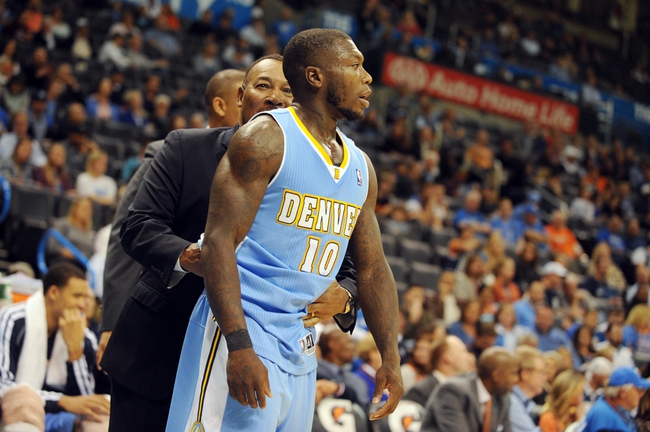 Oct 15, 2013; Oklahoma City, OK, USA; Denver Nuggets point guard Nate Robinson (10) reacts to being ejected from the game against the Oklahoma City Thunder during the second half at Chesapeake Energy Arena. Mandatory Credit: Mark D. Smith-USA TODAY Sports