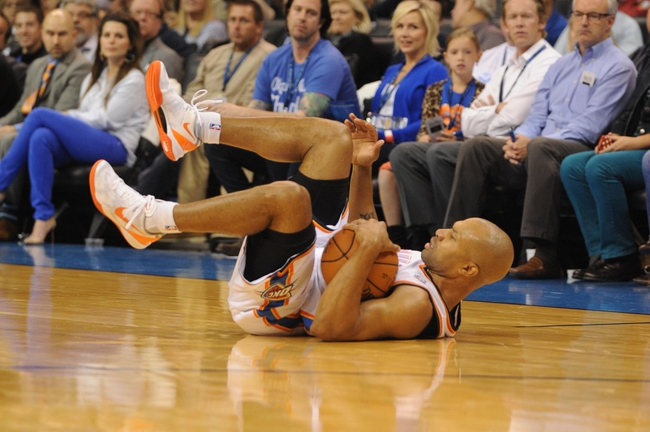 Oct 15, 2013; Oklahoma City, OK, USA; Oklahoma City Thunder point guard Derek Fisher (6) dives for a loose ball in action against the Denver Nuggets during the third quarter at Chesapeake Energy Arena. Mandatory Credit: Mark D. Smith-USA TODAY Sports
