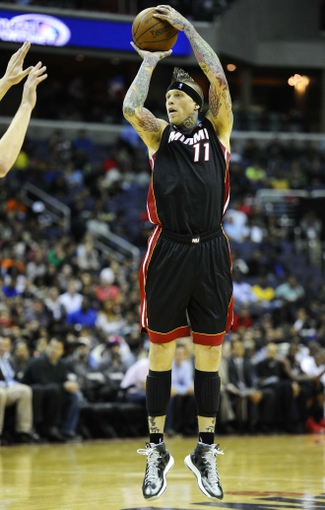 Oct 15, 2013; Washington, DC, USA; Miami Heat power forward Chris Andersen (11) attempts a shot against the Washington Wizards during the second half at the Verizon Center. Mandatory Credit: Brad Mills-USA TODAY Sports
