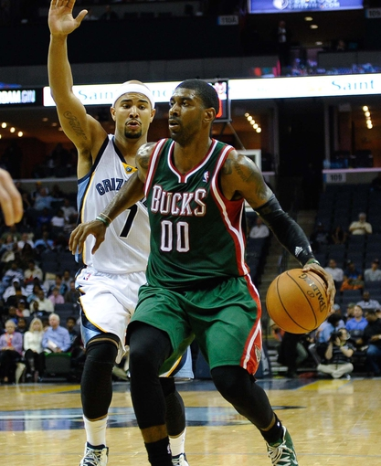 Oct 15, 2013; Memphis, TN, USA; Milwaukee Bucks shooting guard O.J. Mayo (00) handles the ball against the Memphis Grizzlies during the third quarter at FedExForum. Memphis Grizzlies defeat Milwaukee Bucks 102 - 99 Mandatory Credit: Justin Ford-USA TODAY Sports