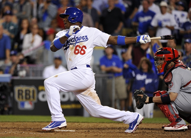 October 15, 2013; Los Angeles, CA, USA;  Los Angeles Dodgers right fielder Yasiel Puig (66) grounds out into a double play in the ninth inning against the St. Louis Cardinals in game four of the National League Championship Series baseball game at Dodger Stadium. Mandatory Credit: Robert Hanashiro-USA TODAY Sports