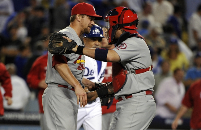 October 15, 2013; Los Angeles, CA, USA;  St. Louis Cardinals relief pitcher Trevor Rosenthal (26) and catcher Yadier Molina (4) celebrate the 4-2 victory against the Los Angeles Dodgers in game four of the National League Championship Series baseball game at Dodger Stadium. Mandatory Credit: Robert Hanashiro-USA TODAY Sports