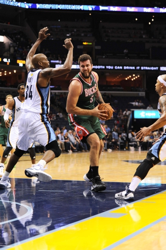 Oct 15, 2013; Memphis, TN, USA; Milwaukee Bucks center Miroslav Raduljica (9) handles the ball against the Memphis Grizzlies during the fourth quarter at FedExForum. Memphis Grizzlies defeat Milwaukee Bucks 102 - 99 Mandatory Credit: Justin Ford-USA TODAY Sports