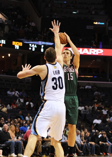 Oct 15, 2013; Memphis, TN, USA; Milwaukee Bucks small forward Olek Czyz (15) takes a jump shot during the fourth quarter against the Memphis Grizzlies at FedExForum. Memphis Grizzlies defeat Milwaukee Bucks 102 - 99 Mandatory Credit: Justin Ford-USA TODAY Sports