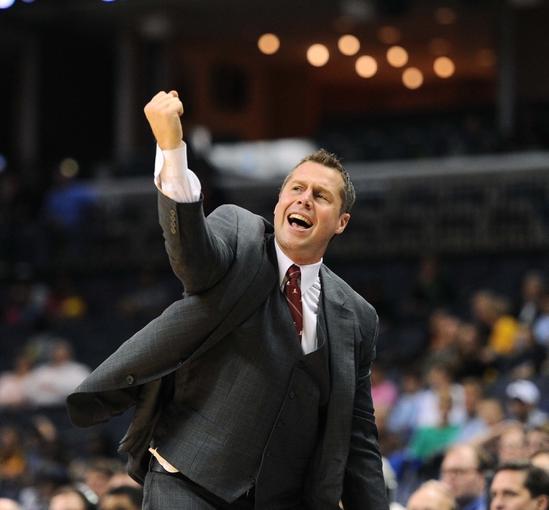 Oct 15, 2013; Memphis, TN, USA; Memphis Grizzlies head coach David Joerger celebrates during the fourth quarter at FedExForum. Memphis Grizzlies defeat Milwaukee Bucks 102 - 99 Mandatory Credit: Justin Ford-USA TODAY Sports